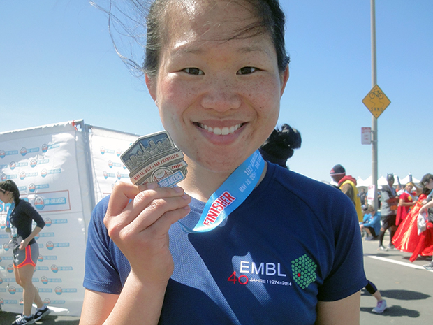 Alumna Siyi Zhang celebrates completing a 12.4K race in San Francisco
