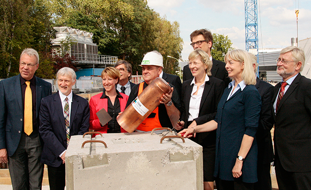 Matthias Wilmanns (far left) joins visitors, construction leaders and CSSB partner representatives as they add a time capsule to the CSSB foundation stone. PHOTO: