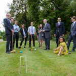 Thornton group plays a leisurely game of croquet.