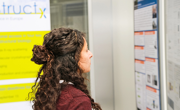 Getting up to date with the latest research and results at the poster session. PHOTO: EMBL/Rosemary Wilson
