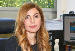Maria Kamper at the her desk.