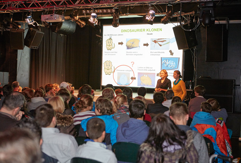 PhD Students Anna Steyer and Katharina Zirngibl explore the science behind Jurassic Park, before the film was shown to more than 200 people at the second EMBL Science Movie Night on 29 October. PHOTO: EMBL Photolab/Marietta Schupp