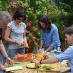 Former group members muck in to prepare a surprise birthday dinner. PHOTO: Iouri Motorine