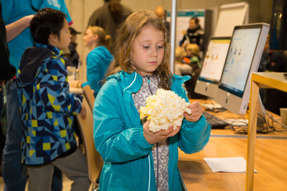 A young visitor takes a closer look at a 3D model of a ribosome. PHOTO: EMBL/Rosemary Wilson