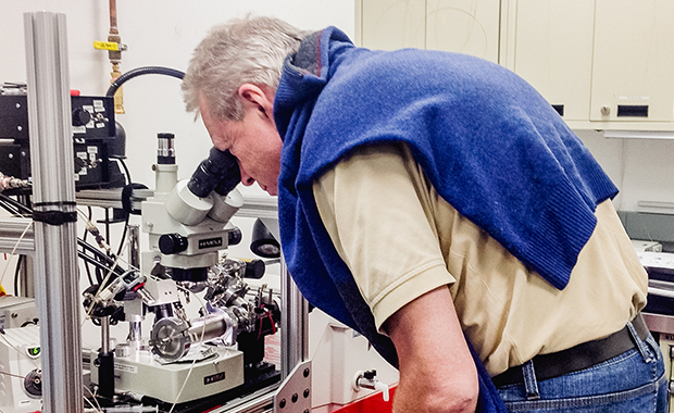 Wilmanns checks that nozzles for sample delivery are working during a test run. PHOTO: EMBL/Daniel Passon