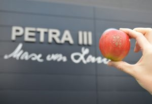The beamlines at PETRA III logo and Max von Laue hallwith an DESY-Day apple