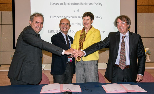 EMBL and ESRF extend their Joint Structural Biology Group. From left to right: L. Sanchez-Ortiz and F. Sette (ESRF), S.Schumacher and S.Cusack (EMBL) PHOTO: ESRF