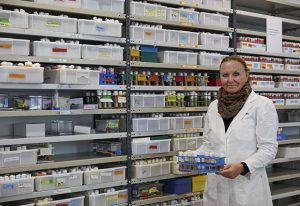 Lab manager Anna Cyrklaff takes a tray of fly specimens to be transferred into new vials