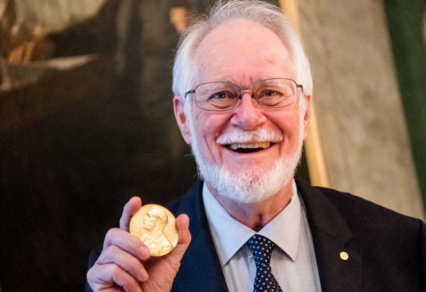 Jacques Dubochet holding his Nobel medal during Nobel week. PHOTO: Alexander Mahmoud ©Nobel Media AB 2017