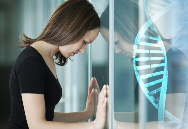 Depressed person against window with double helix superimposed - Genetic risk factors for depression