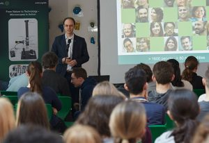 Robert Prevedel talks about EMBL and microscopy at the Internationale Gesamtschule Heidelberg. PHOTO: EMBL/Hugo Neves