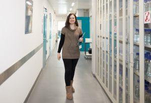 EMBL IT support engineer Vasiliki Karyoti walking down a corridor