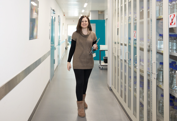 EMBL IT support engineer Vasiliki Karyoti walking down a corridor