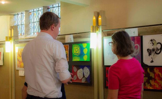 Two visitors to PDBe art exhibition
