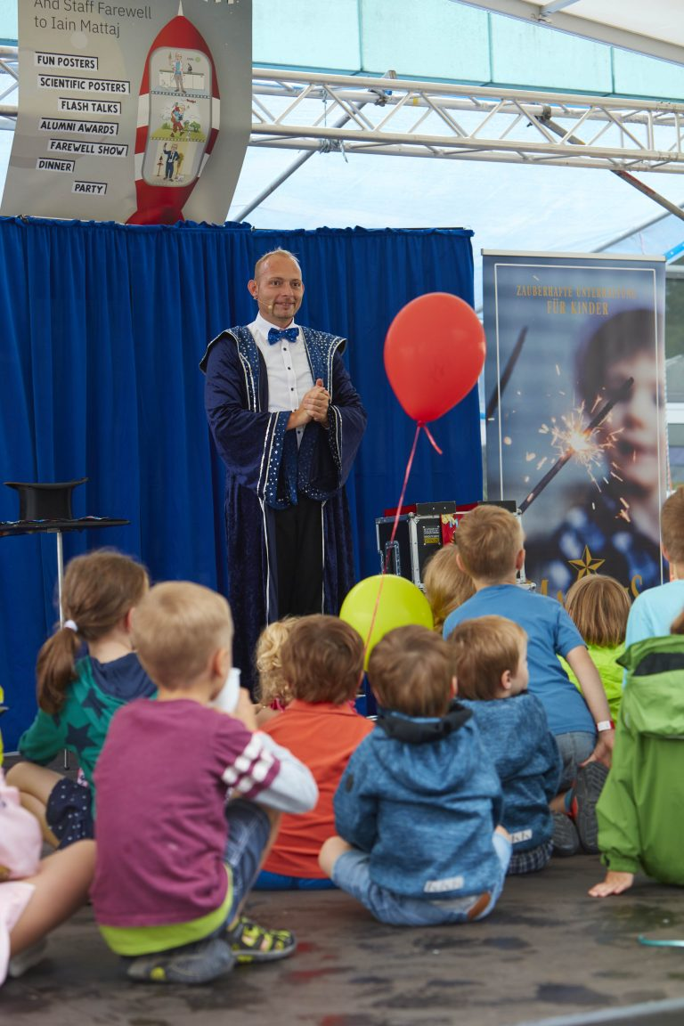 A magician cast a smile on the face of children and parents alike. PHOTO: Photolab /EMBL