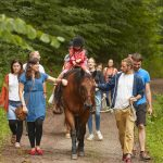 Thanks to the help of many volunteers, children took pony-rides through the surrounding forest. PHOTO: Photolab /EMBL