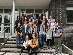 A group of young students in front of the EMBL site in Hamburg.