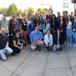 A group of scientists and students on DESY campus.