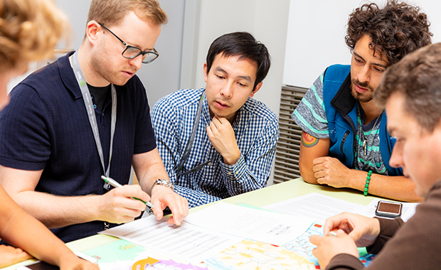 Daniel Schraivogel (left) works with other EIPOD postdocs at the Corporate Summer School