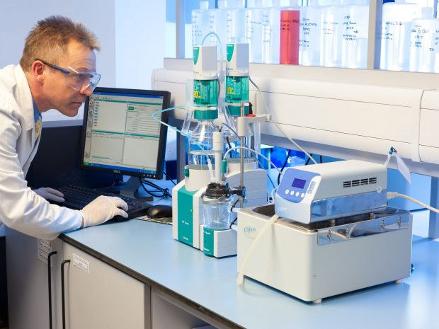 Lab technician working on enzyme