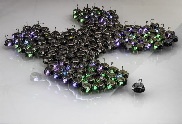 The robots used during the experiments. The shape of this particular swarm is a hand-made illustration of the technique. PHOTO: reprinted with permission from AAAS