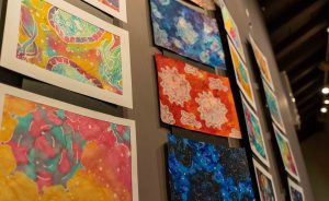 Protein-inspired paintings from the 2019 PDB Art Exhibition. PHOTO: Oana Stroe/EMBL-EBI