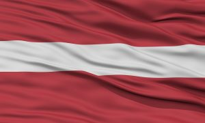 The national flag of Latvia: A carmine field bisected by a narrow white stripe (one-fifth the width of the flag)
