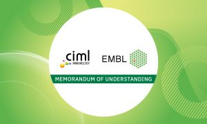 Green background with white sphere bearing the logos of the two MoU signors, EMBL and CIML