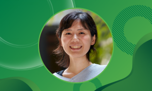 Portrait photo of EMBL group leader Miki Ebisuya against a green background.