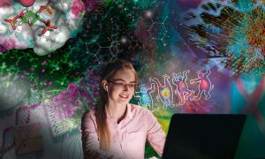 A young woman is participating in an online conference. She is seated in front of her computer, surrounded by images representing scientific ideas