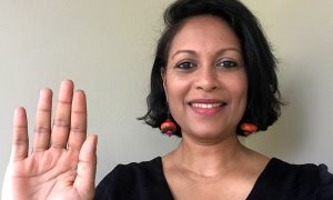 Roshni Mooneeram, EMBL Equality, Diversity and Inclusion Officer, strikes the #ChooseToChallenge pose with her hand high, pledging to call out bias and actively question stereotypes.