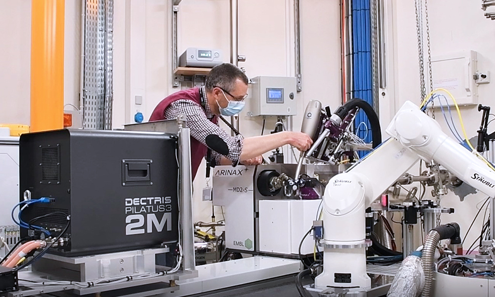 Scientist working on an instrument of the MASSIF-1 beamline